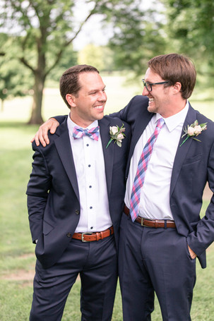 groom and groomsmen laughing Kent Country Club Wedding Grand Rapids