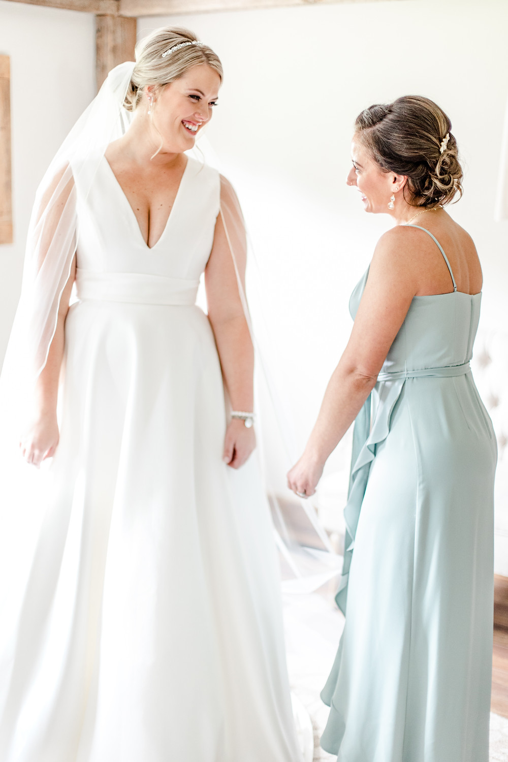 Josh and Andrea wedding photography husband and wife photographer team michigan Black Barn Wedding Venue rives junction spring bride and bridesmaid getting ready