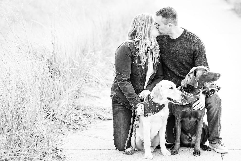 Engagement Photos Jean Klock Park Saint Joseph MI cute couple kissing with two dogs