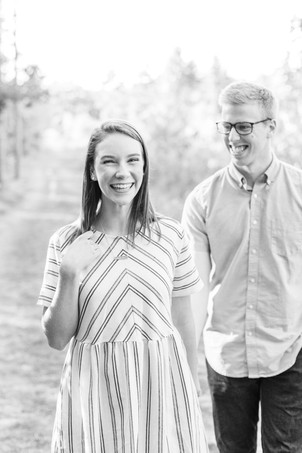 Engagement Photos Riley Trails Holland Michigan Engaged Couple walking toward camera smiling