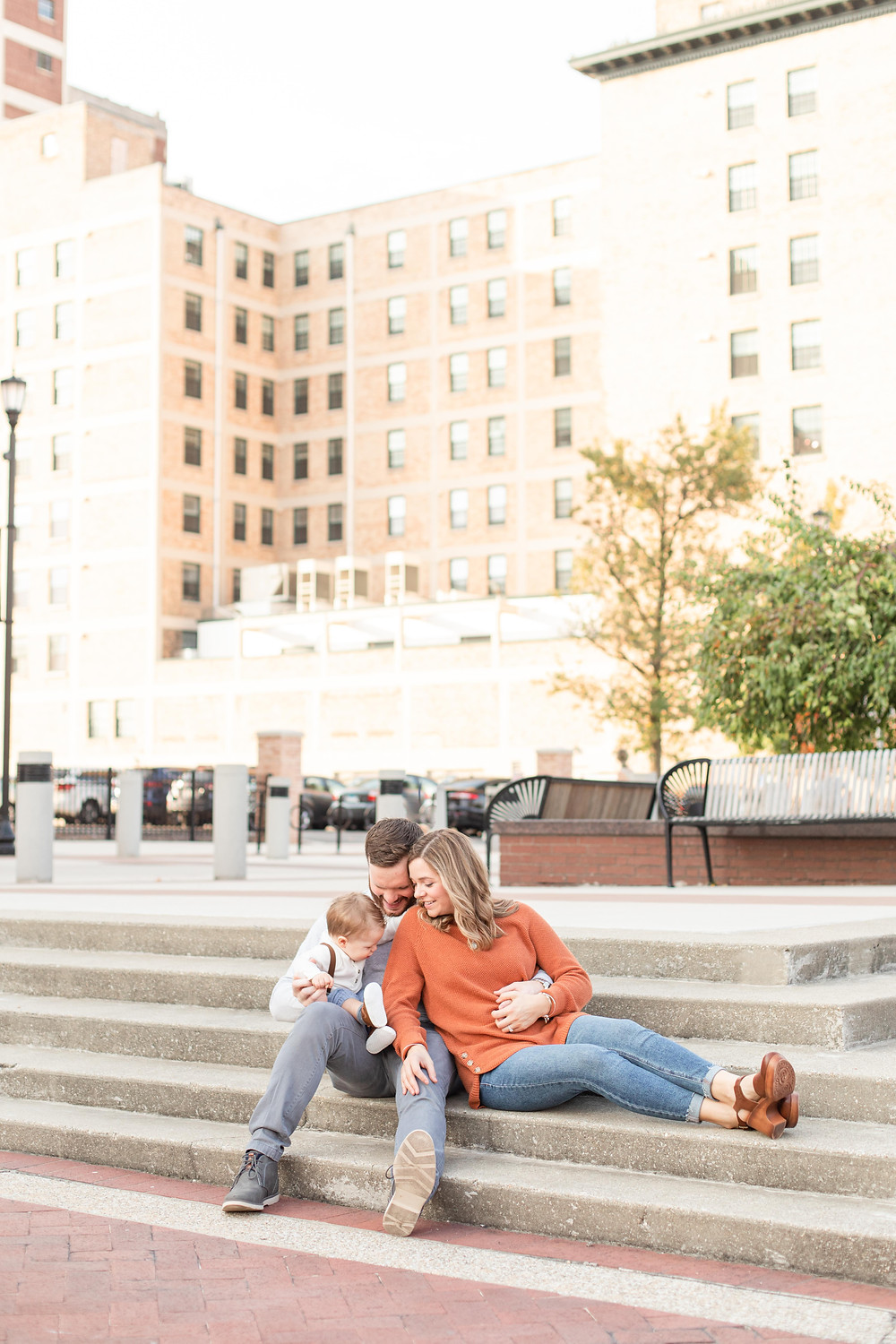 Josh and Andrea photography engagement photos south bend Indiana cute family sitting smiling
