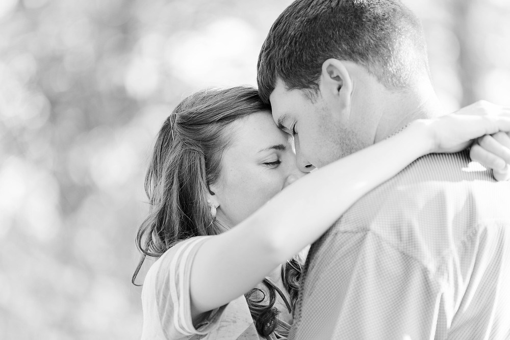 engaged couple snuggle tender moment Something Blue Berry Farm Wedding Venue