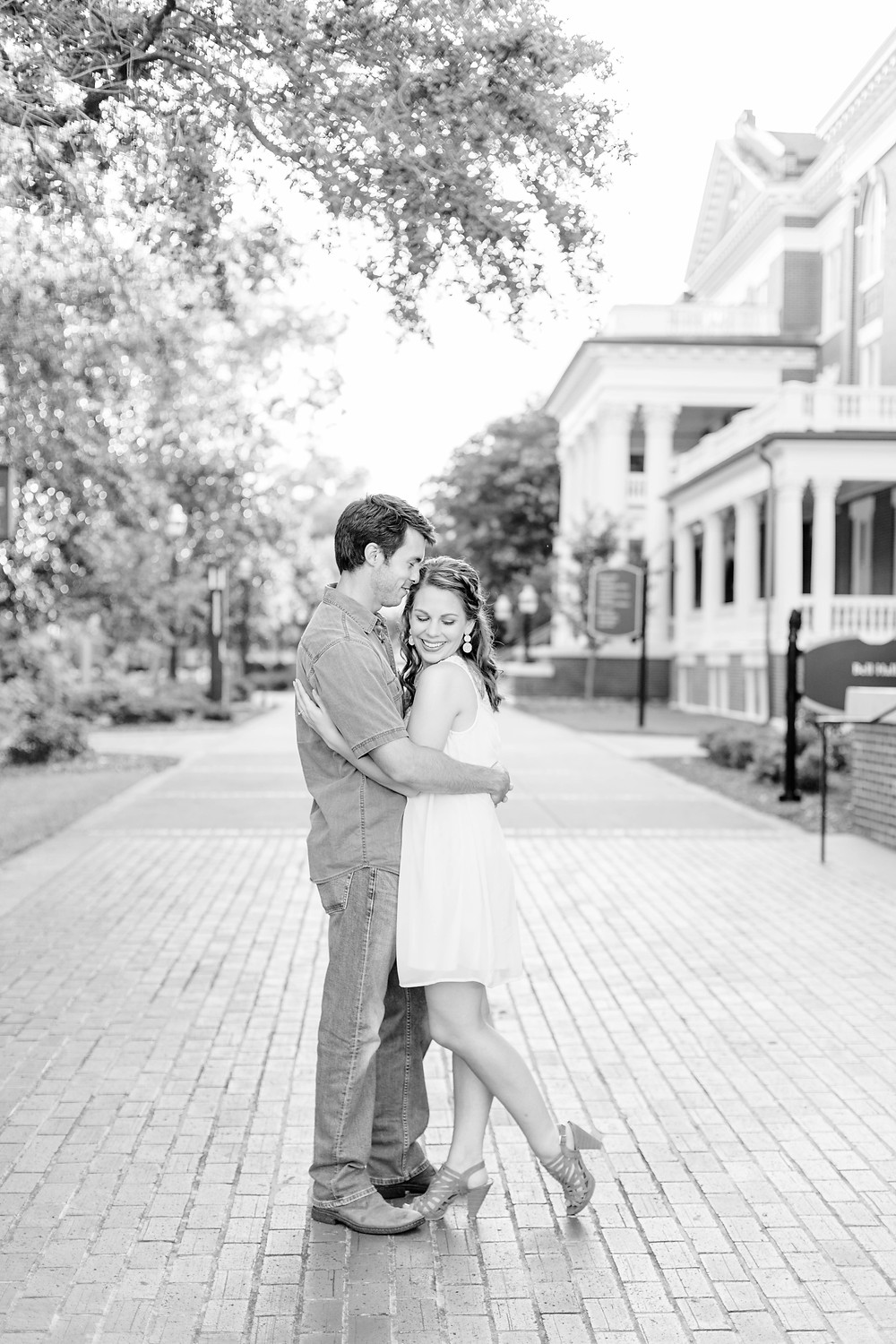 engagement photos cute couple hugging Milledgeville GA Georgia College and State University