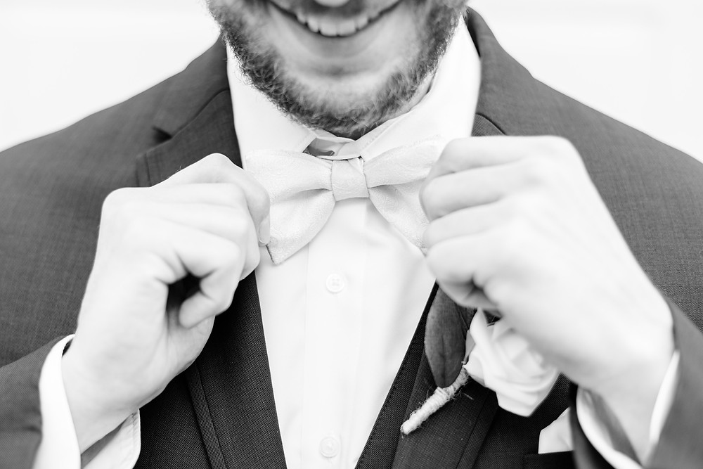 josh and Andrea photography husband and wife team michigan winter wedding groom smiling getting ready