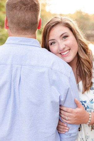 engagement photos cute couple head on shoulder milham park kalamazoo michigan