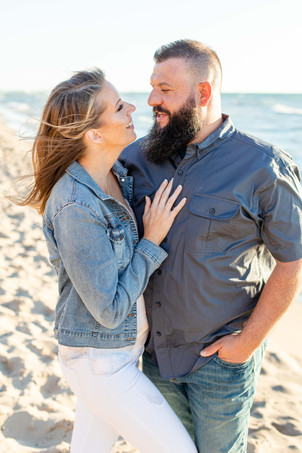 Engagement Photos South Haven Beach Michigan Engaged Couple hugging smiling
