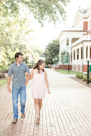 engagement photos cute couple walking Milledgeville GA Georgia College and State University