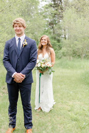 bride and groom first look smiling in the details byron center truer design