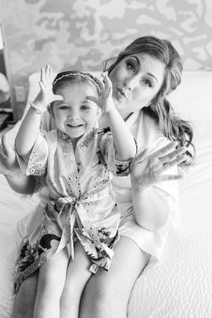 Bride with little girl smiling wedding American 1 event center Jackson michigan