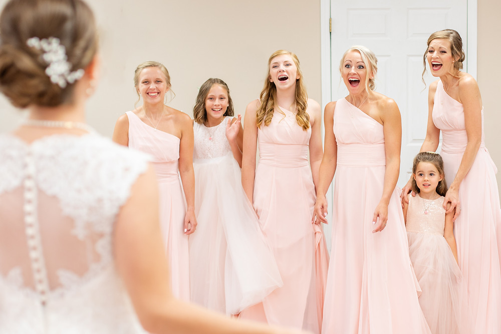 first look with bridesmaids light pink dresses Milledgeville Georgia