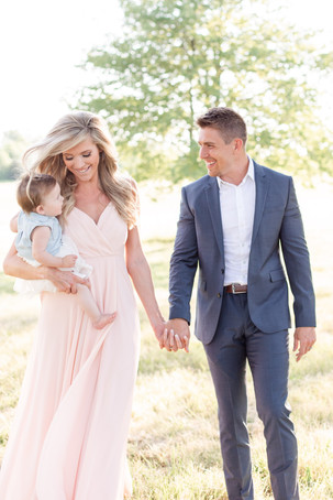 South Haven Michigan Cute Family Photo Session little girl mom and Dad walking smiling in a field