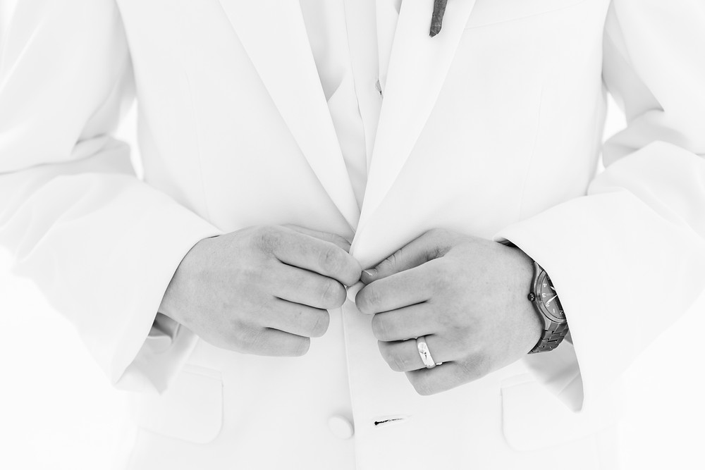 josh and Andrea photography husband and wife team michigan winter wedding south haven groom buttoning jacket