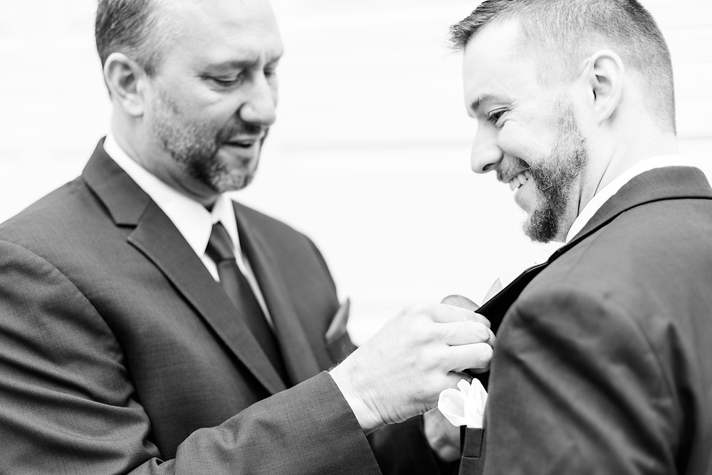 josh and Andrea photography husband and wife team michigan winter wedding father and son getting ready smiling