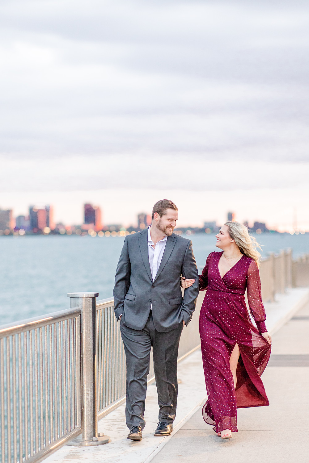 Josh and Andrea wedding photography husband and wife photographer team michigan engagement session photo shoot fiance detroit walking smiling downtown