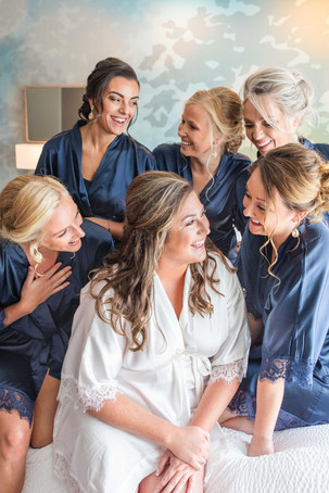 Bride and bridesmaids laughing wedding American 1 event center Jackson michigan