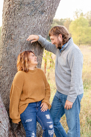 Engagement Photos Al Sabo Land Preserve Kalamazoo Michigan standing by tree cute couple