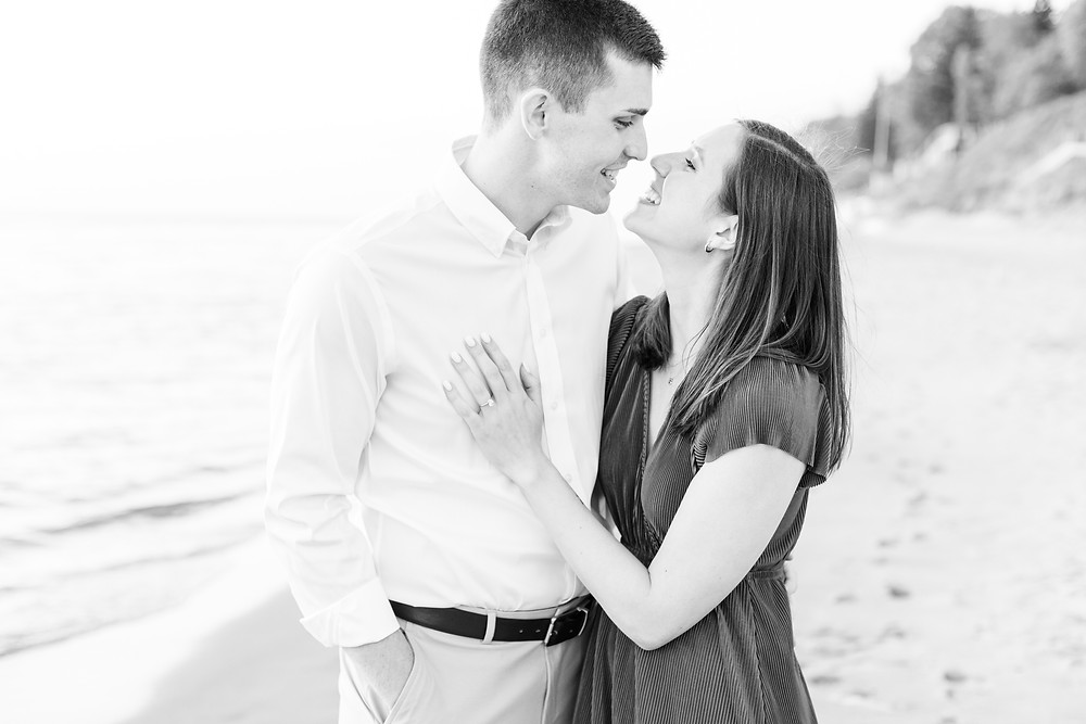 Josh and Andrea wedding photography husband and wife photographer team michigan engagement pictures session photo shoot fiance tunnel park smiling
