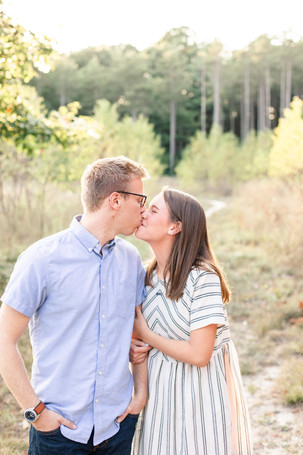 Engagement Photos Riley Trails Holland Michigan Engaged Couple kissing