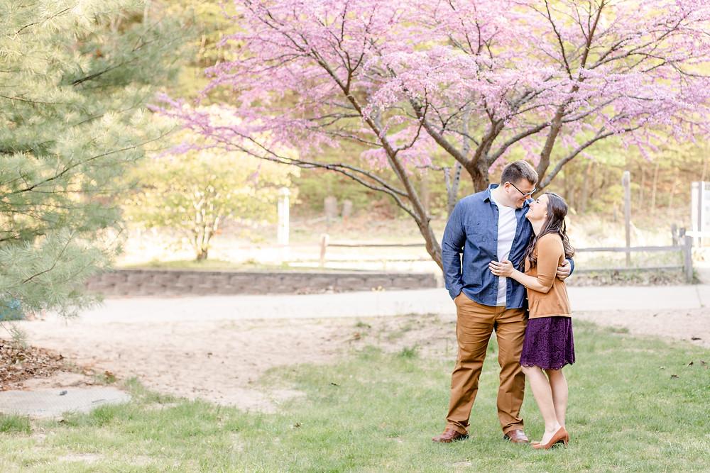 Engagement Photos Van Buren State Park Couple Kissing under purple tree