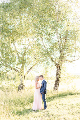 South Haven Michigan Cute Couple Engagement Photo Session standing in a field