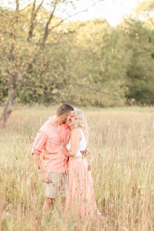 Engagement Photos Al Sabo Land Preserve Kalamazoo Michigan cute couple smiling laughing Open Field
