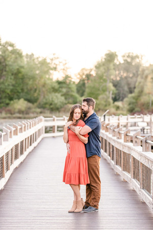 Cute couple standing on bridge Pickerel Lake Park Grand Rapids engagement session