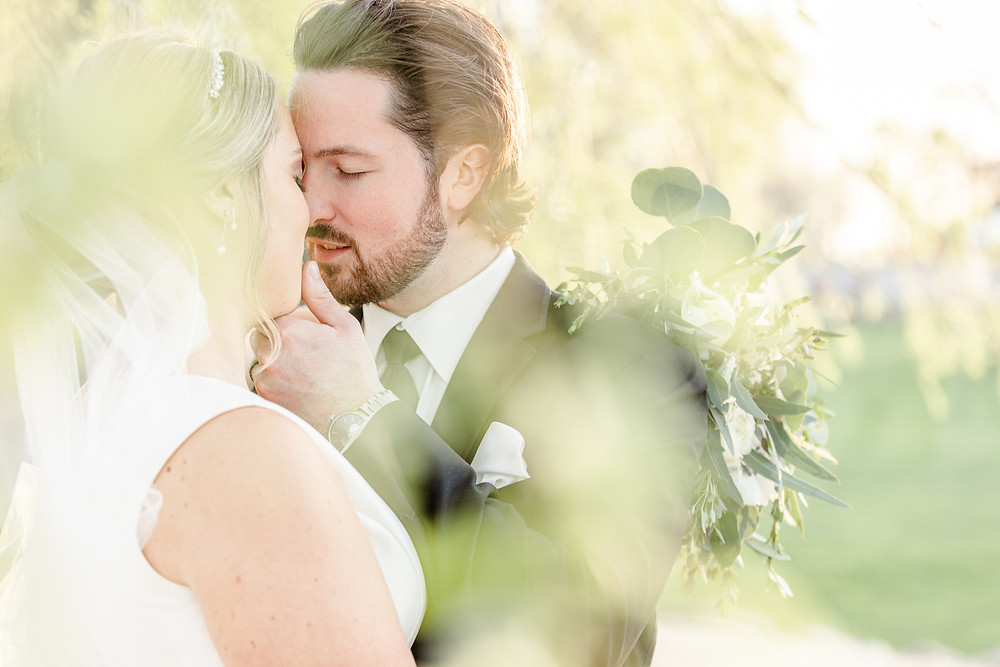 Josh and Andrea wedding photography husband and wife photographer team michigan Black Barn Wedding Venue rives junction spring bride and groom kissing