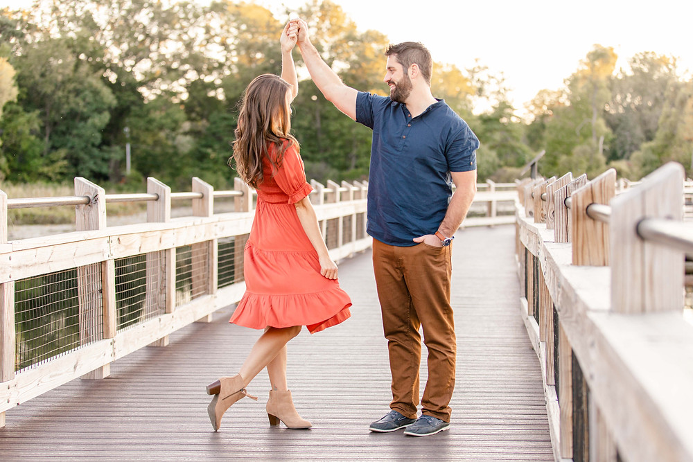 Cute couple dancing on the bridge Pickerel Lake Park Grand Rapids engagement session