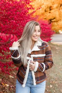 pretty women smiling red flowers fall photo shoot
