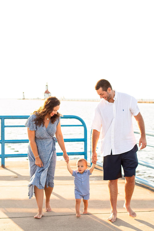 family of 3 photo session Silver Beach Saint Joseph Michigan walking on pier