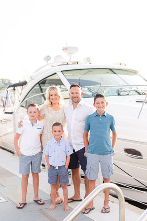 family of 5 standing by yacht boat docked at new buffalo michigan