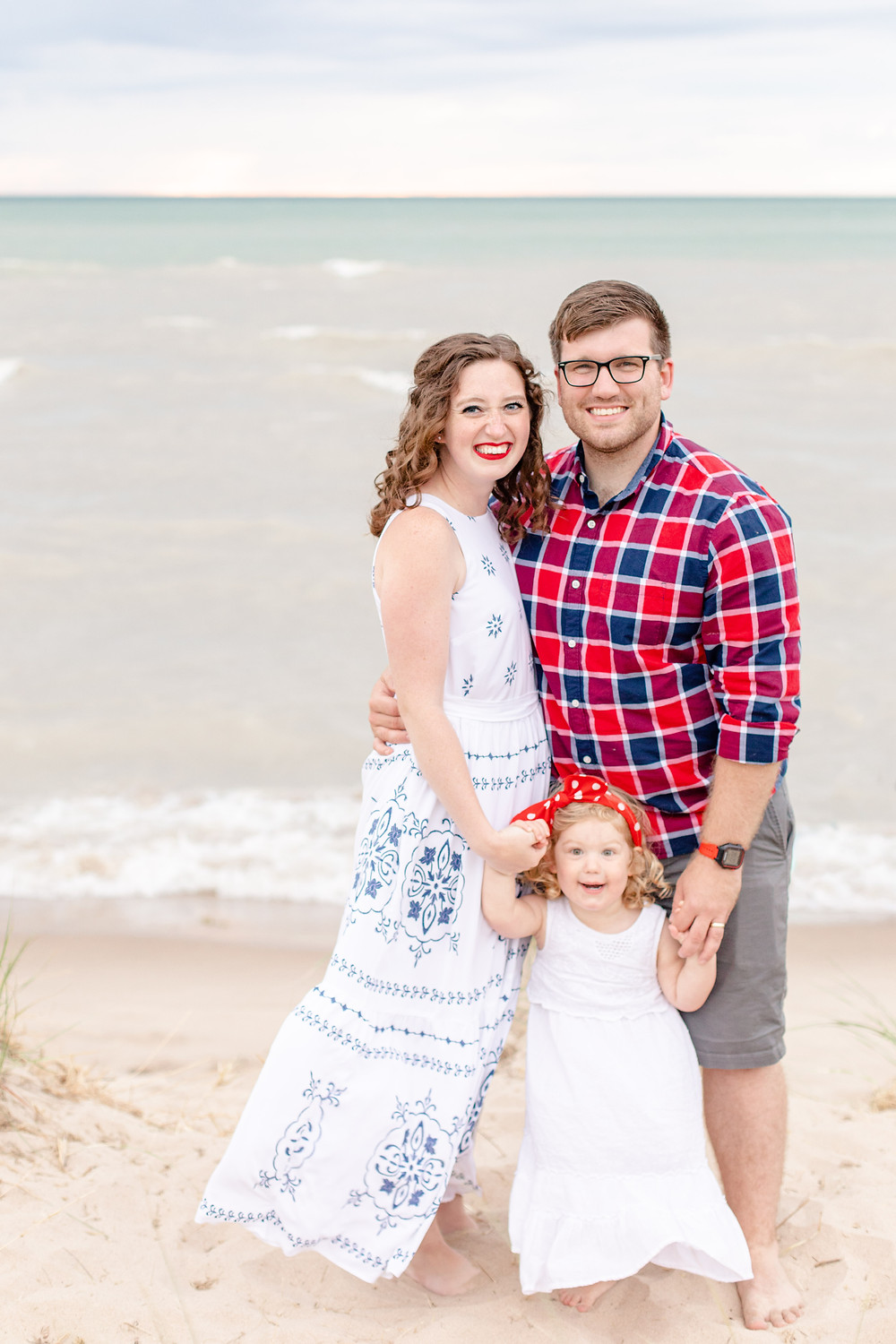 mom dad and daughter on the beach Lake Michigan south haven family shoot red white and blue outfits