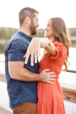 Cute couple ring Pickerel Lake Park Grand Rapids engagement session
