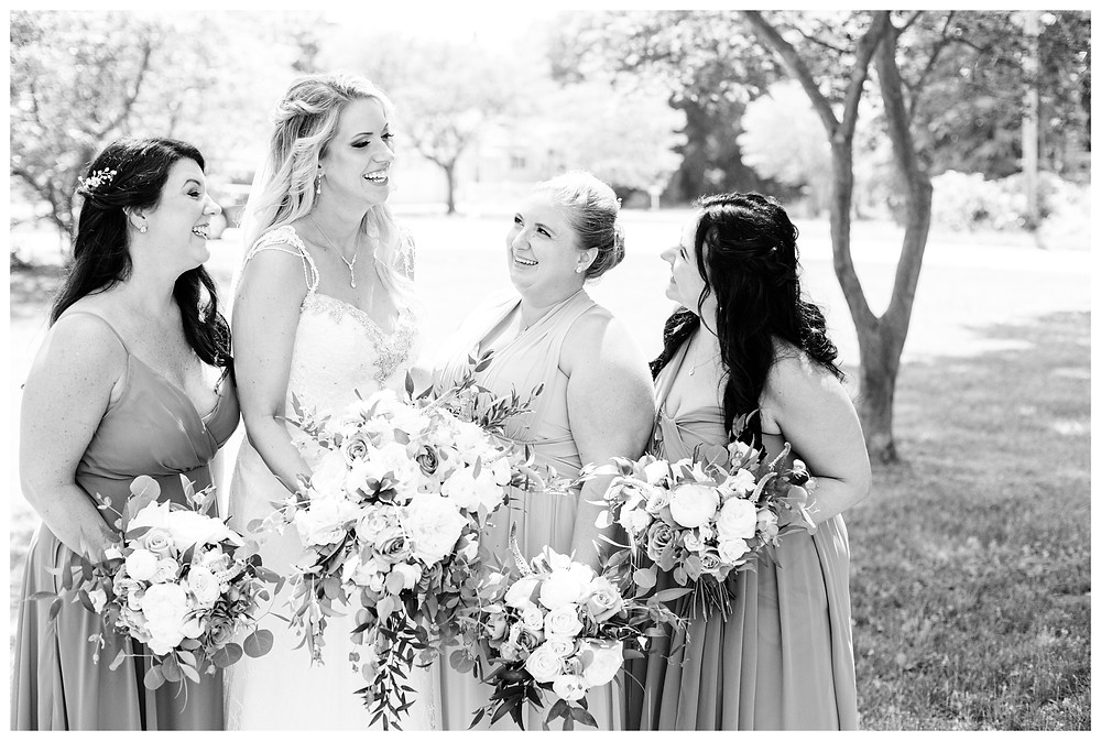 Josh and Andrea wedding photography husband and wife photographer team michigan south haven pictures Black River Barn luxury elegant wedding venue spring bride bridal party bridesmaids