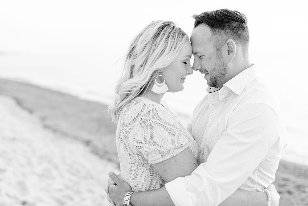 husband and wife sweet moment photo beach Lake Michigan