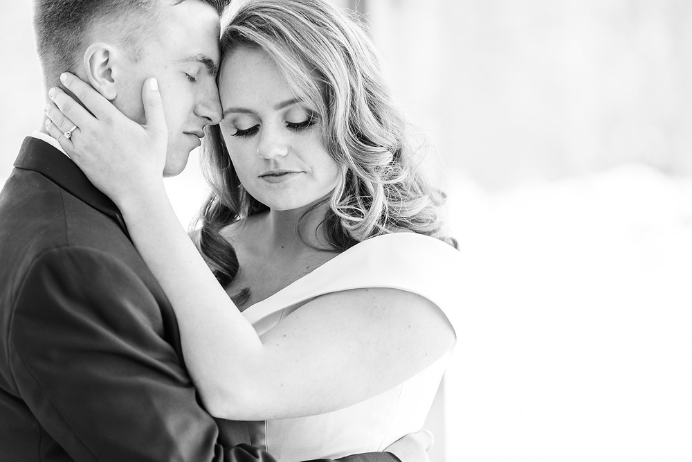 Josh and Andrea wedding photography husband and wife photographer team michigan venue Bay Pointe Woods shelbyville winter wedding bride and groom intimate nuzzle
