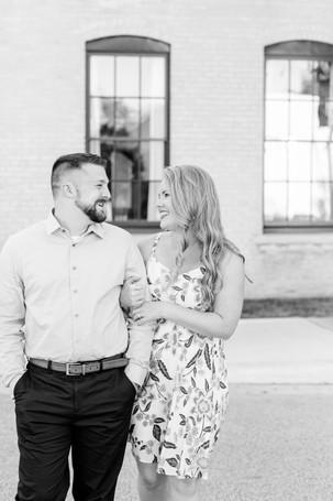 engagement photos couple walking in front of journeyman distillery weddings three oaks michigan