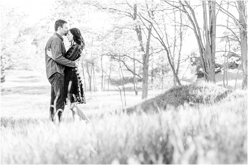 Josh and Andrea wedding photography husband and wife photographer team michigan pictures Lake Harbor Park engagement pictures session photo shoot fiance kissing