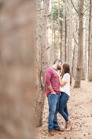 Cute couple kissing woods provin trails Grand Rapids engagement session