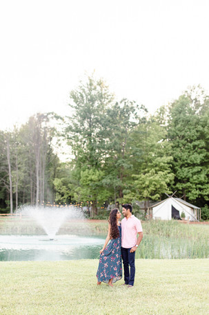 couple standing in front of water fountain and tent The Fields of Michigan South Haven luxury glamping experience