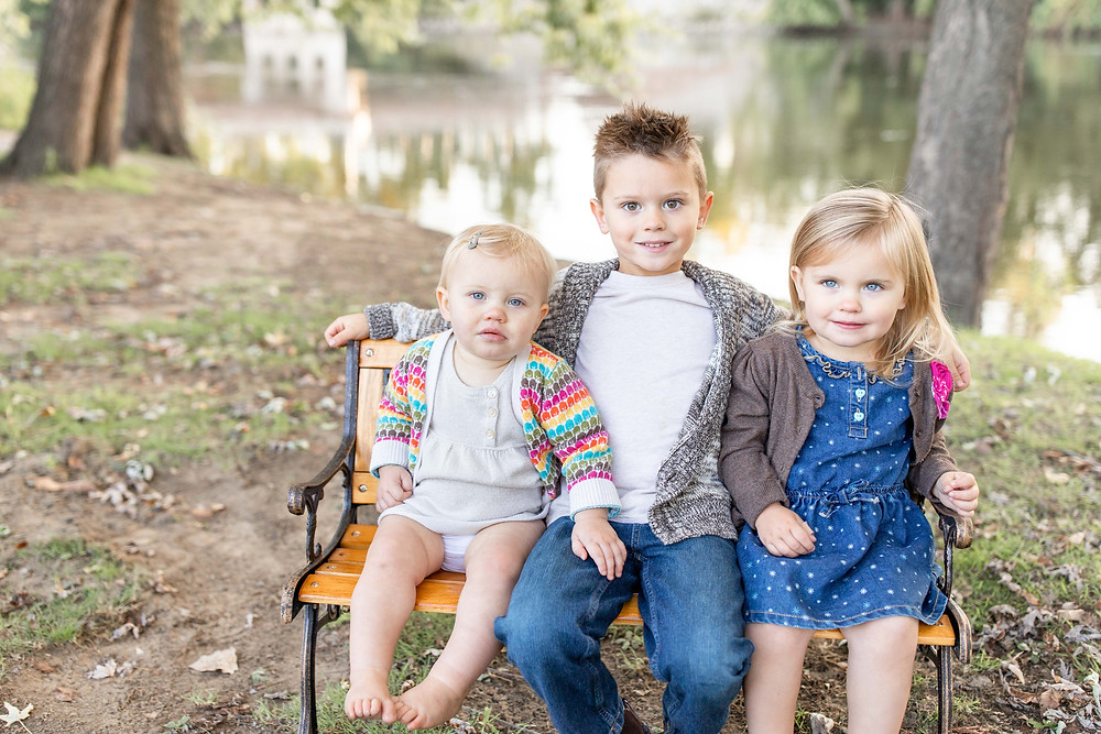 josh and Andrea photography husband and wife team cute family niles michigan brother and sisters sitting on a bench