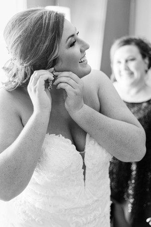 Bride getting ready smiling wedding American 1 event center Jackson michigan
