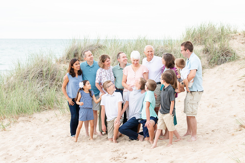 extended family photos shoot laughing together on the beach dune grass Lake Michigan South Haven Michigan