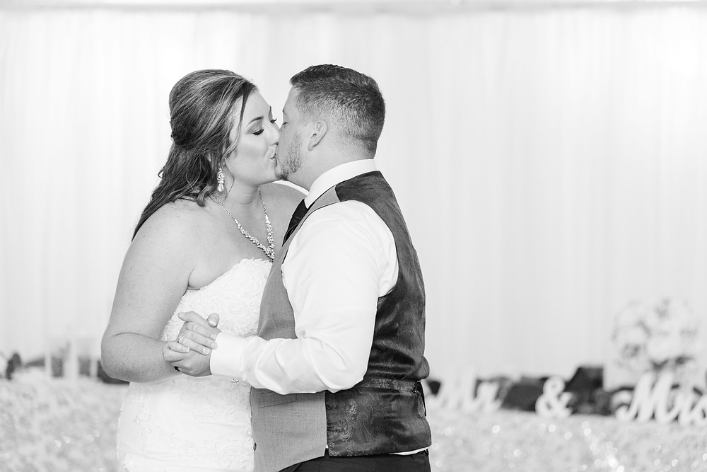 Bride and groom cute couple dancing kissing wedding American 1 event center Jackson michigan
