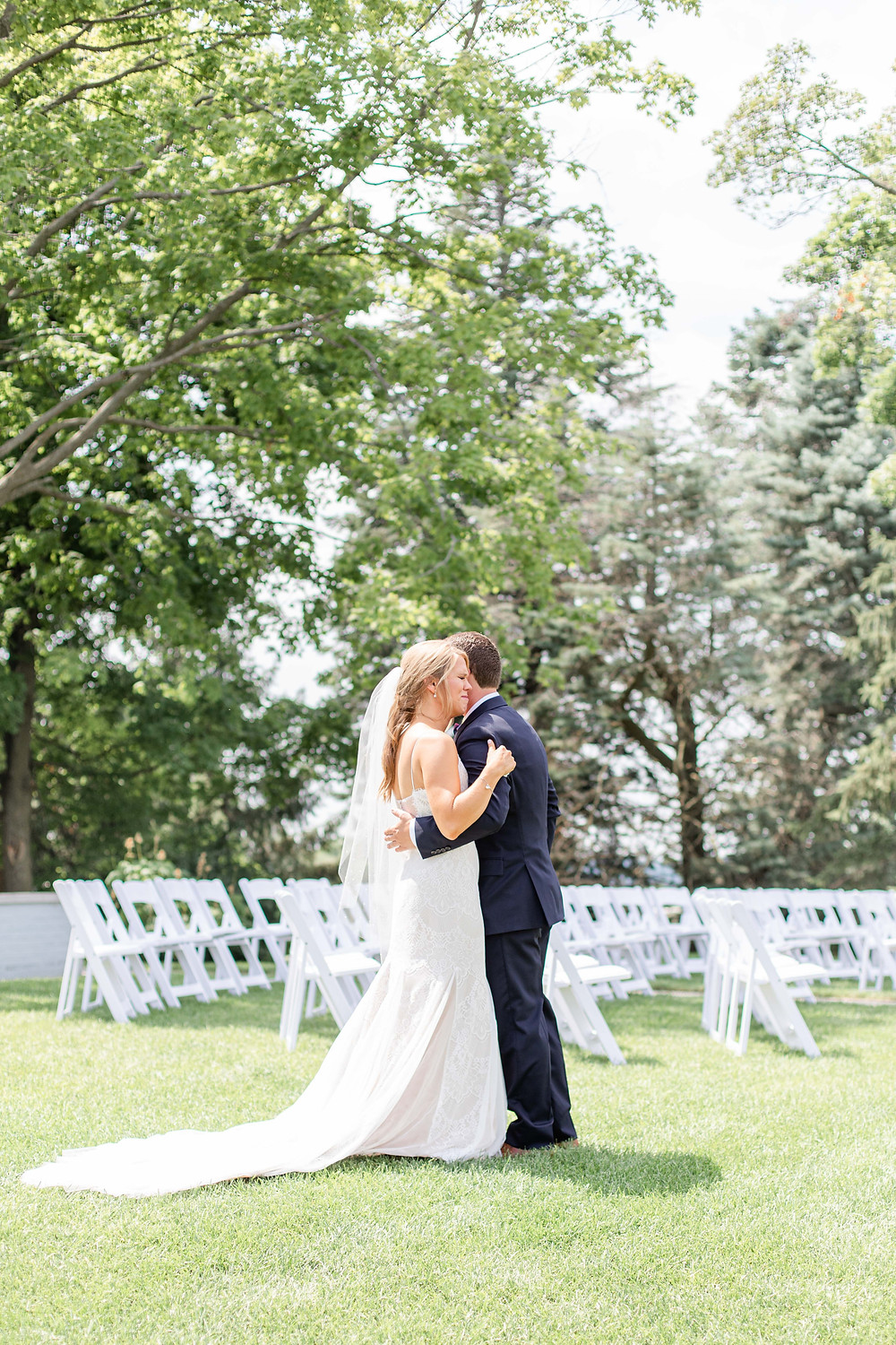 bride and groom first look hugging crying Kent Country Club Wedding Grand Rapids