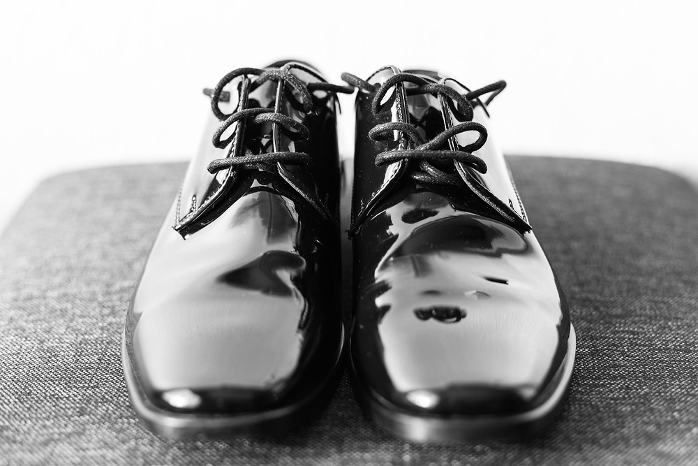 josh and Andrea photography husband and wife team michigan winter wedding south haven groom shoes detail shot