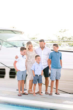 family of 5 photos standing laughing by yacht boat new buffalo michigan