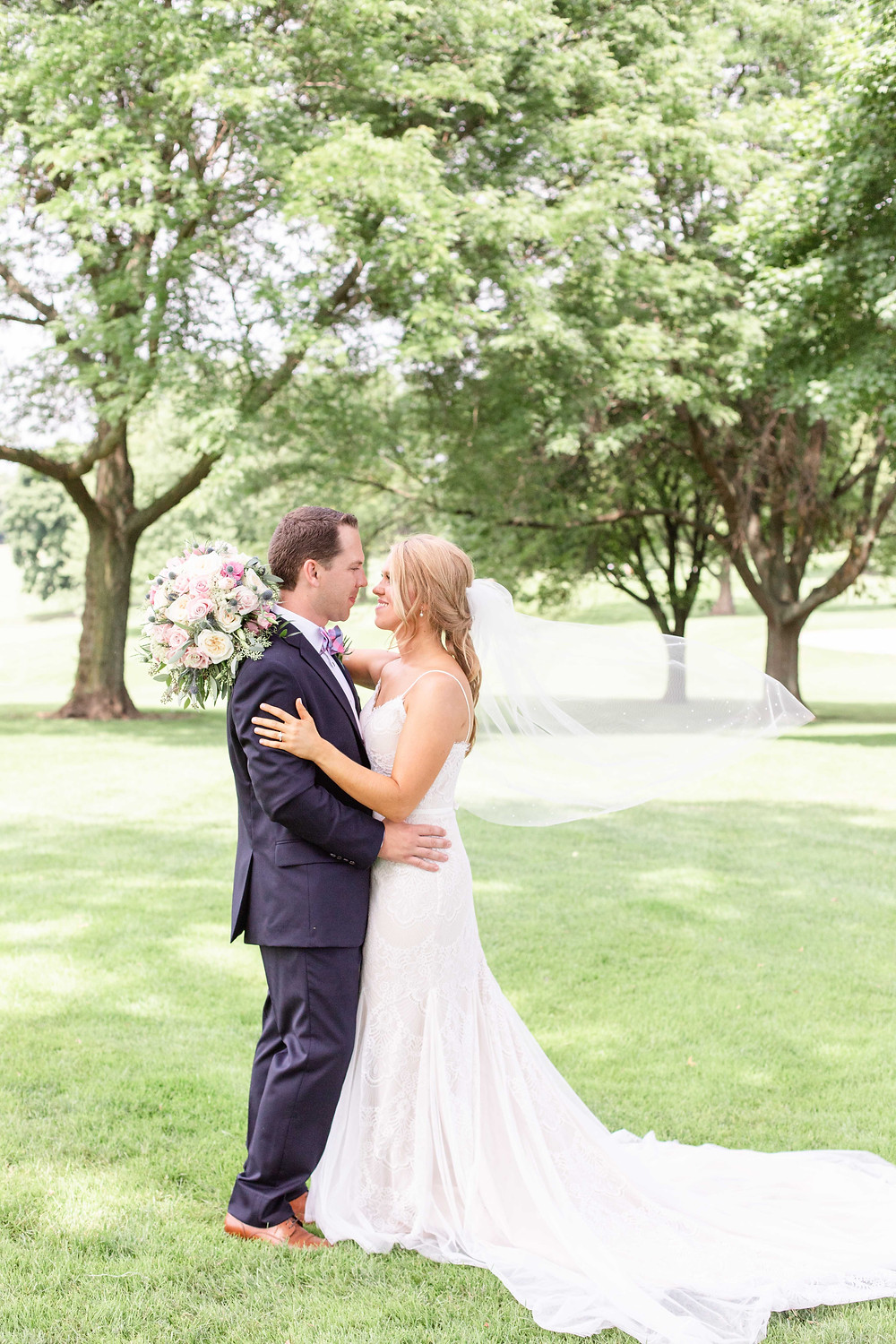 bride and groom veil flying Kent Country Club Wedding Grand Rapids