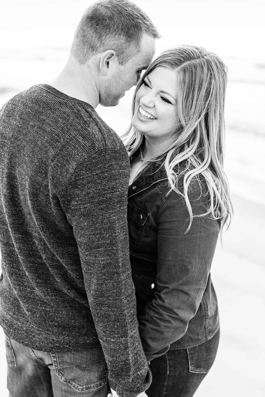 Engagement Photos Jean Klock Park Saint Joseph MI cute couple laughing
