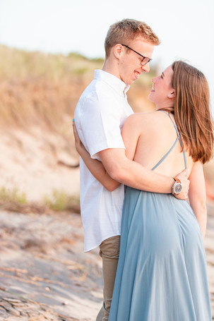 Engagement Photos Tunnel Park Beach Holland Michigan Engaged Couple hugging